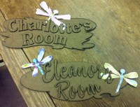 Room signs laid out after being laser cut.