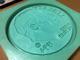 Large silicone mold of a dime.