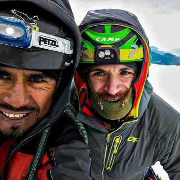 two men with helmet on mountain