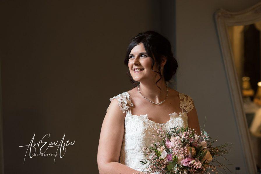 A bride posing for photos before her wedding ceremony
