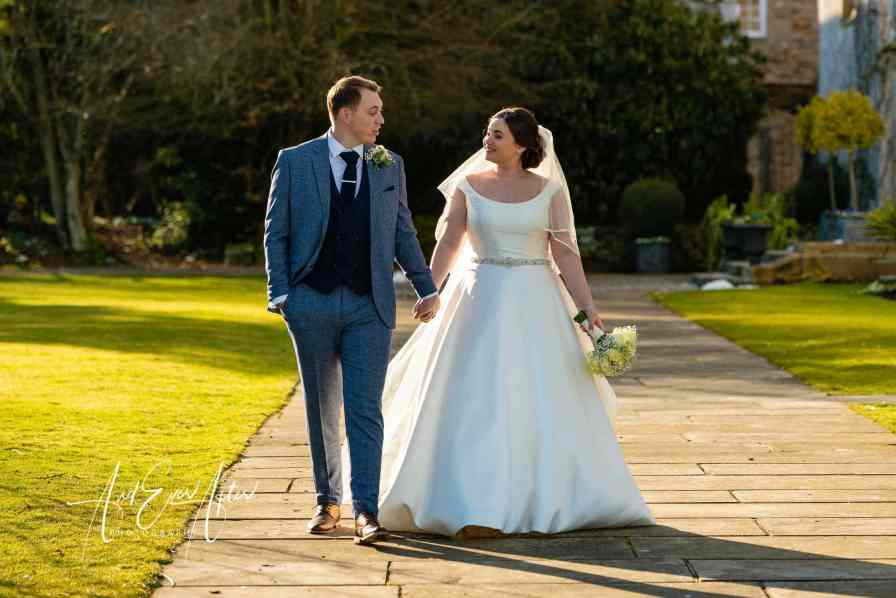 bride and groom walking in the grounds of lartington hall