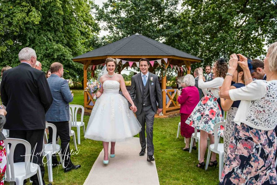 Outdoor wedding ceremony, Solberge Hall, bride and groom in garden