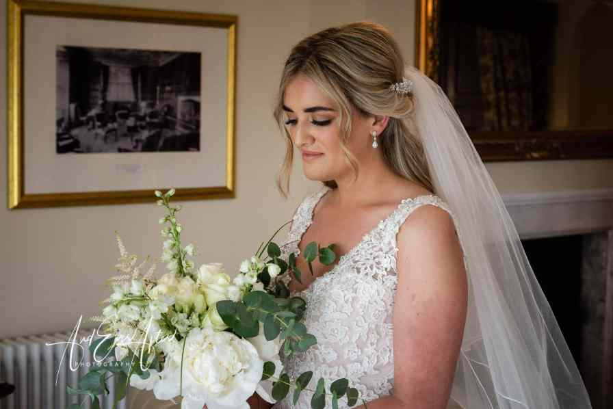 wedding day bridal preparations at Goldsborough Hall, bride looking at her wedding bouquet