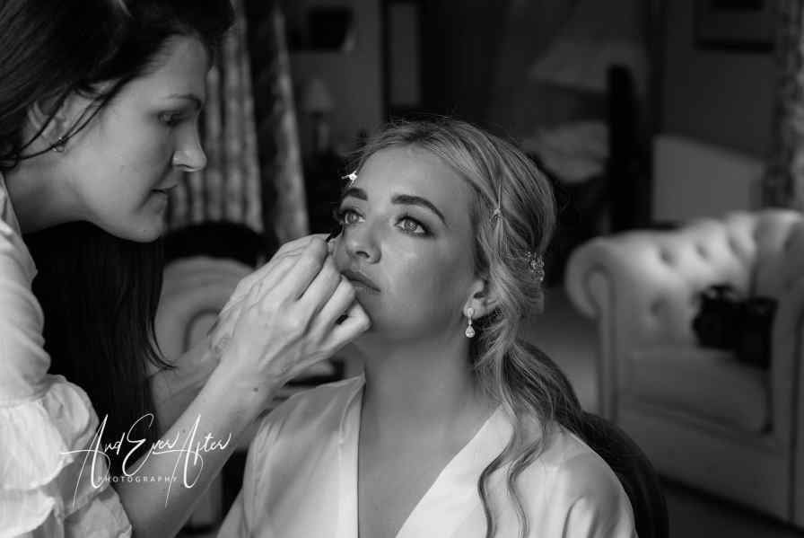 wedding day bridal preparations at Goldsborough Hall with the bride having her make up done