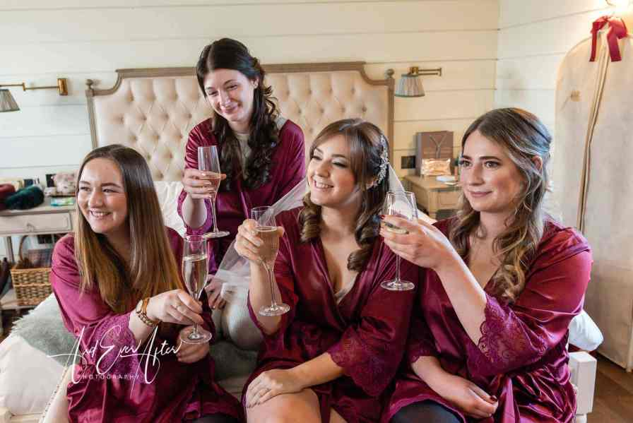 bride to be with bridesmaids raising a glass
