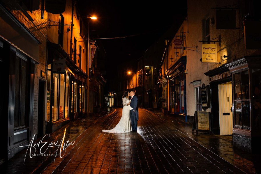 bride and groom posing in a street in richmond north yorkshire