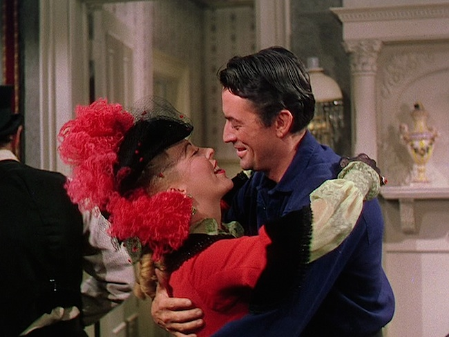 """Andrea King and Gregory Peck embracing in """"The World In His Arms."""" Universal, 1952."""