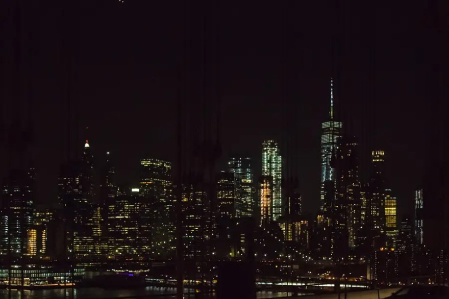 views of Manhattan at night from the Manhattan Bridge