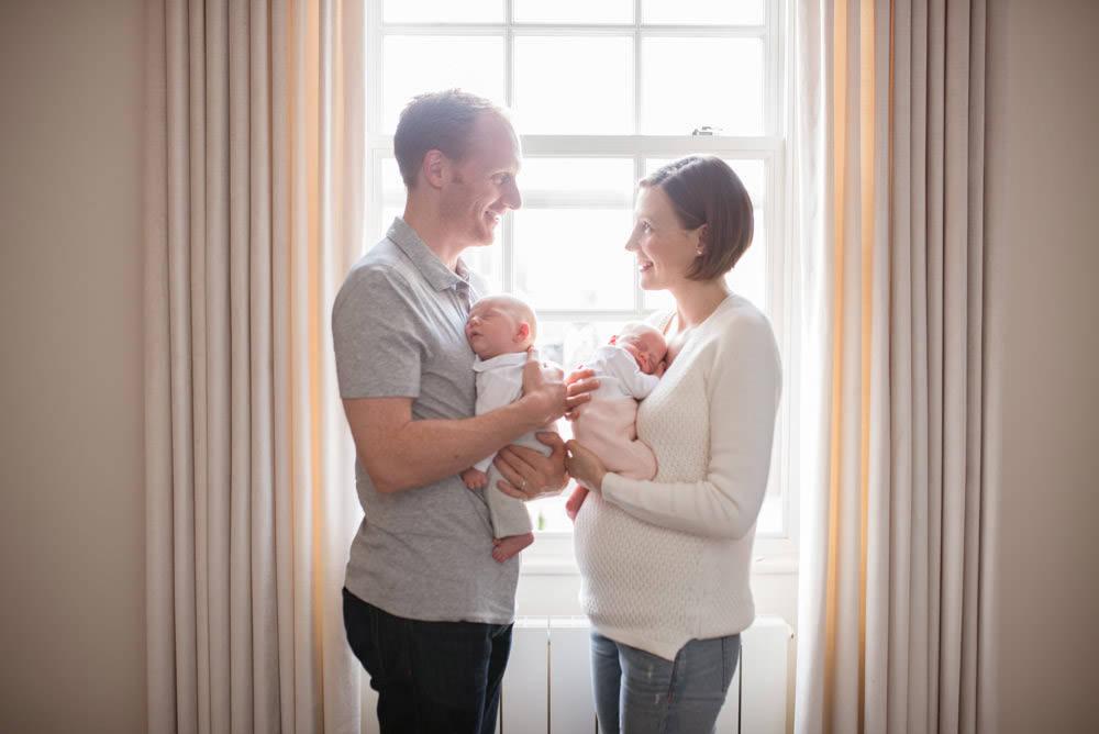 Backlit newborn photographer