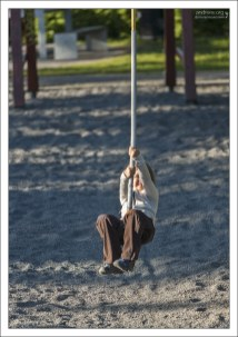 Саша на детской площадке.