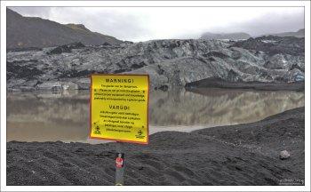 Предупреждающий знак об опасности нахождения рядом с ледником.