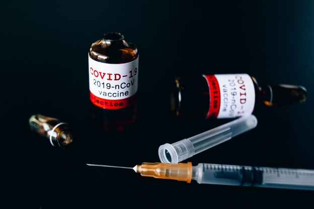covid vaccine bottles and syringe