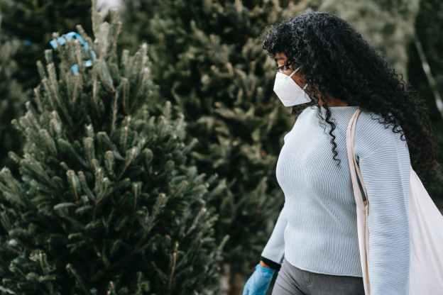 black woman in medical mask choosing firs