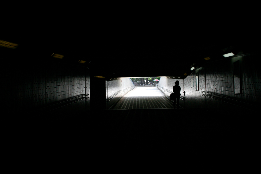 girl silhouette on a underground passage