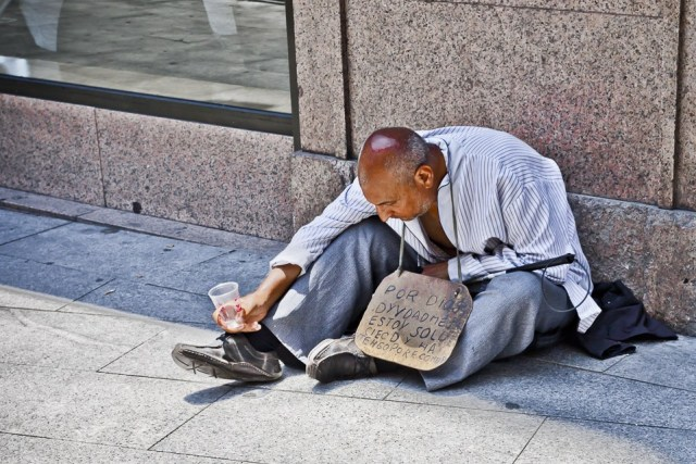 Business Evaluation with image of a beggar