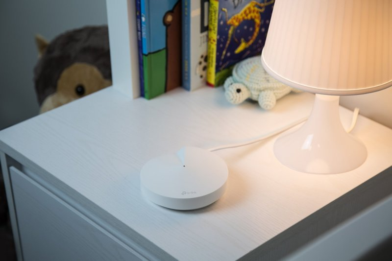 TP-Link Deco M5 on a nightstand