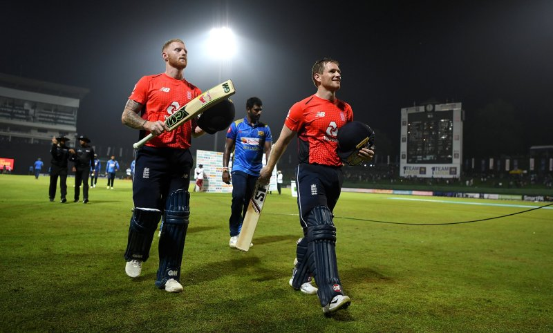 KANDY, SRI LANKA - OCTOBER 17:  England captain Eoin Morgan and Ben Stokes leave the field after winning the 3rd One Day International match between Sri Lanka and England at Pallekele Cricket Stadium