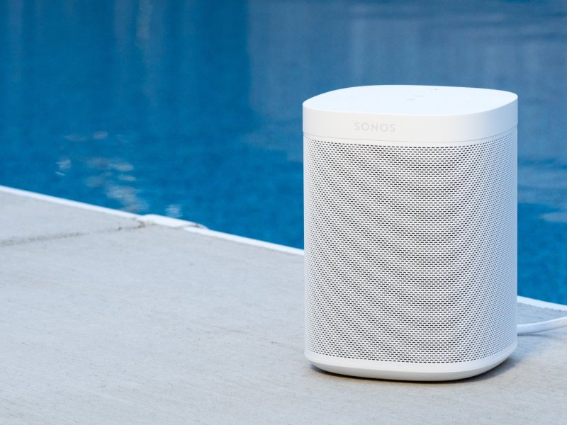 Sonos One in white next to a pool