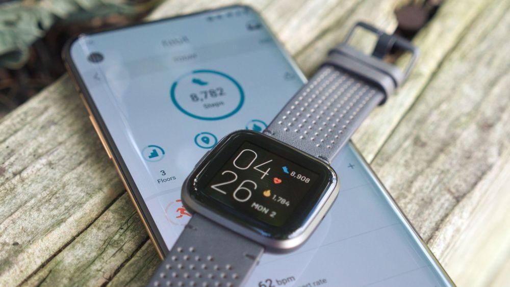 Fitbit Versa 2 on top of OnePlus 7 Pro