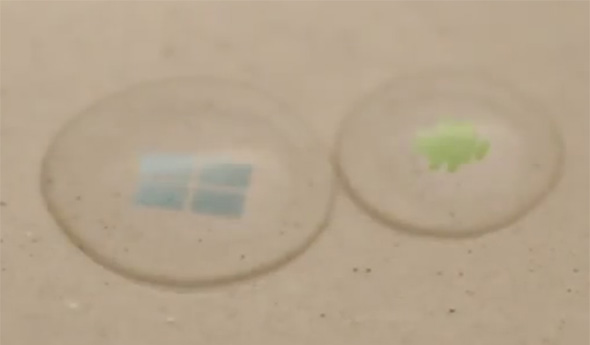 Windows und Android Logo in Wassertropfen. Foto: youtube.