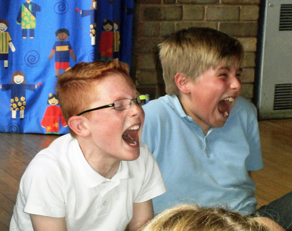 Two boys laughing in one of Andy's School Visiits