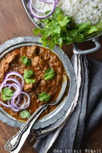 Rogan Josh (Kashmiri Red Curry with Meat) in Metal Bowl on Wooden Table