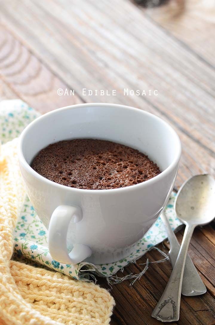Whole Healthy Chocolate Mug Cake with Vintage Spoons on Side