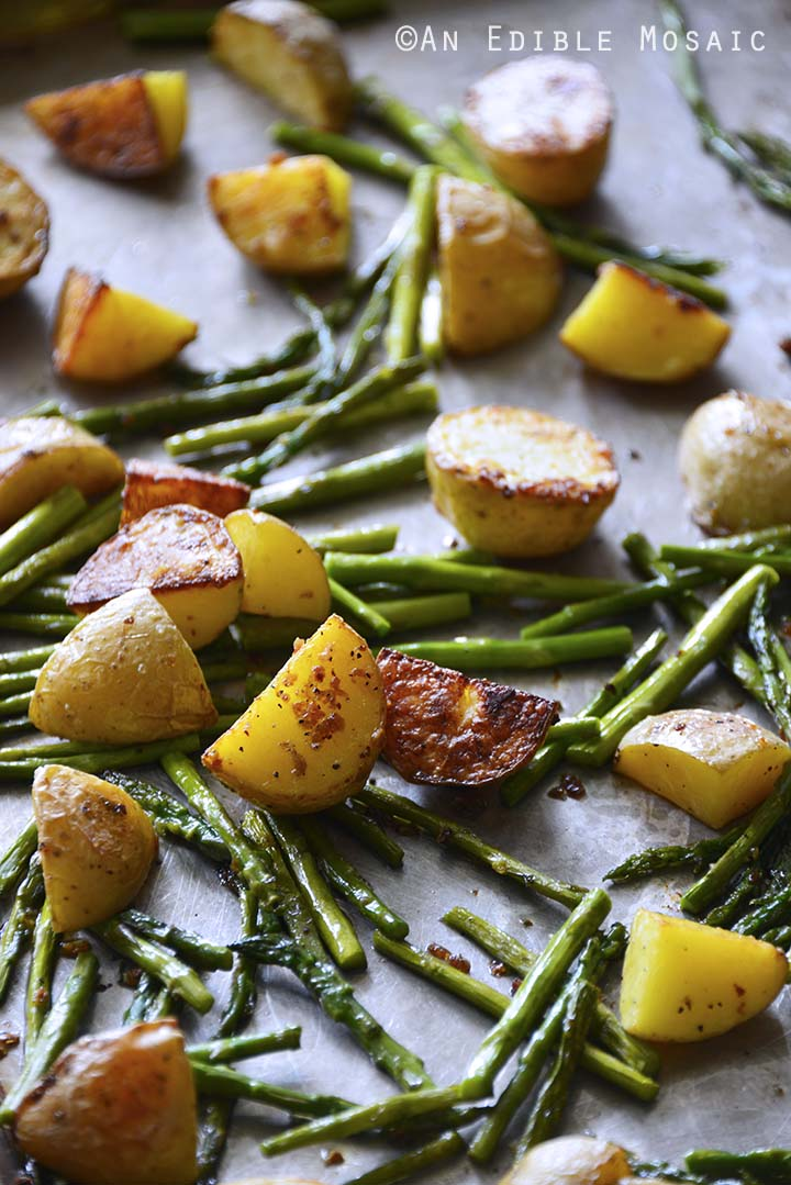 Garlic-Roasted New Potato and Asparagus Salad with Fresh Mint and Goat Cheese on a Baking Sheet