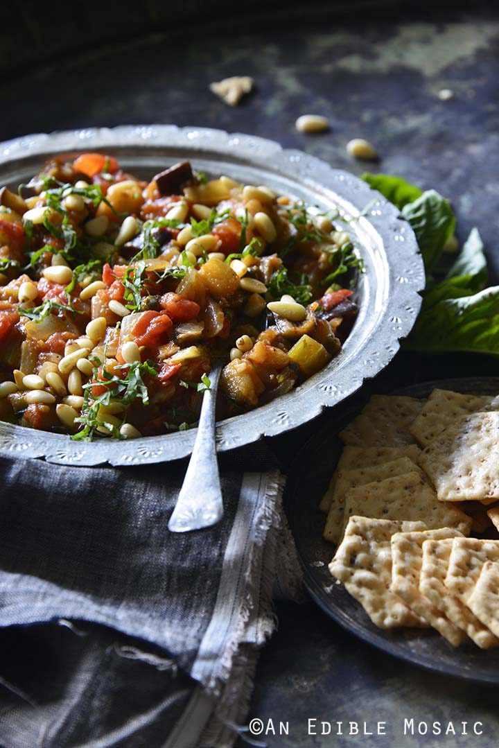 Caponata {aka Sicilian Eggplant Relish} with Crackers Side View Vertical Orientation