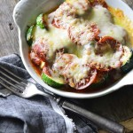 15-Minute Low-Carb Zucchini Pizza Bake for One in White Casserole Dish on Wooden Table