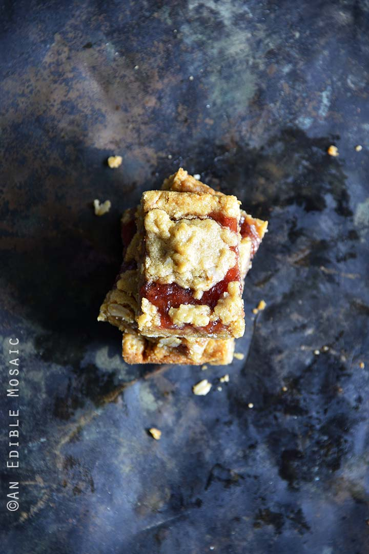 Crumble-Topped Peanut Butter & Co. Peanut Butter Strawberry Jam Bars Top View Metal Background