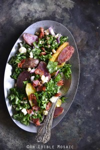 Kale Salad with Roasted Fingerling Potatoes, White Beans, and Warm Bacon Dressing Metal Background Top View Vertical Orientation