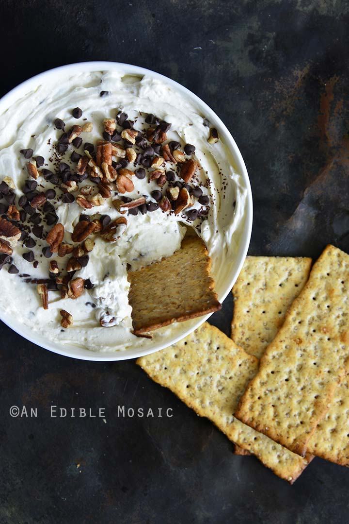 Easy Sugar-Free Turtle Cheesecake Dip with Crackers Being Dipped