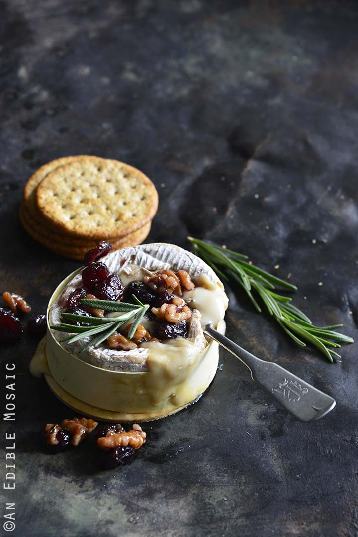Gooey Baked Goat Brie with Spiced Rosemary-Scented Honey and Red Wine Cranberries Front View Vertical Orientation