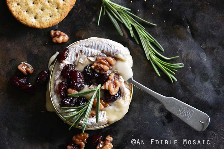 Gooey Baked Goat Brie with Spiced Rosemary-Scented Honey and Red Wine Cranberries Top View
