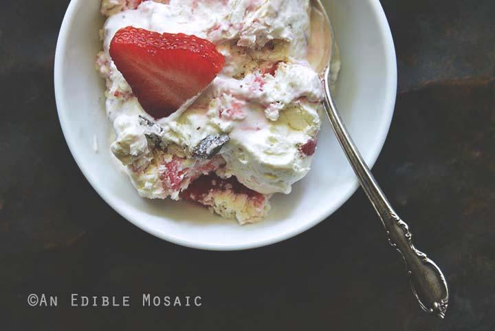 Close Up of Low-Carb Keto No-Churn Vanilla Cheesecake Ice Cream with Strawberry Swirl and Chocolate Chunks
