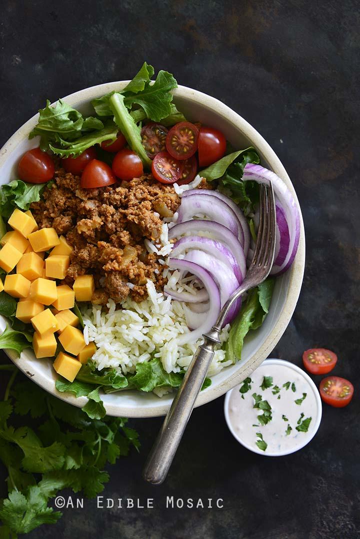 Turkey Taco Rice Salad Bowls with Creamy Tex-Mex Dressing on Dark Tray