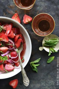 Sweet and Savory Strawberry Salad with Rosé Reduction and Fresh Mint and Glasses of Rosé