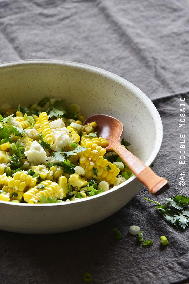 Mexican-Inspired Warm Garlic Butter Corn Salad with Cotija on Brown Fabric