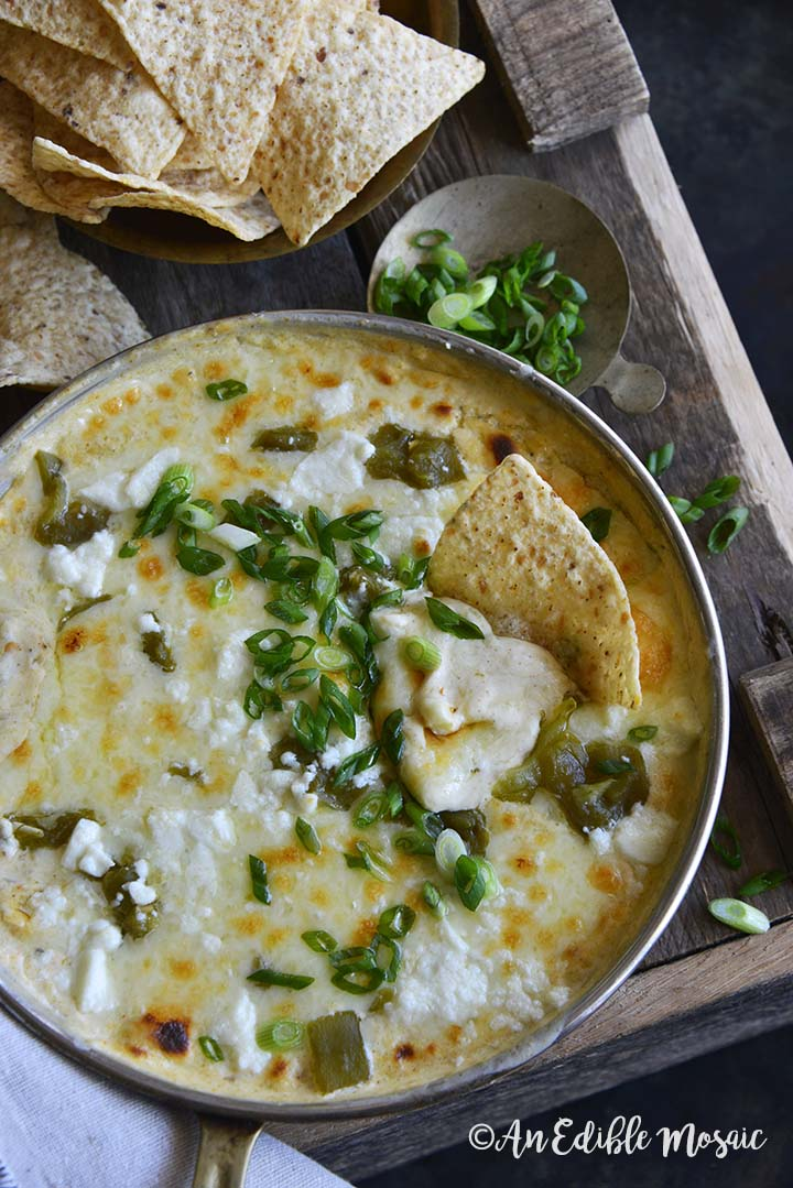 Pan of Easy Low Carb Chile Relleno Dip (15 Minute Dip Recipe) with Scallions on Wooden Table
