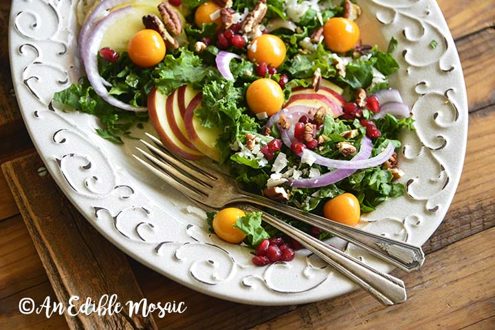 Festive Christmas Salad Recipe on White Platter on Wooden Table