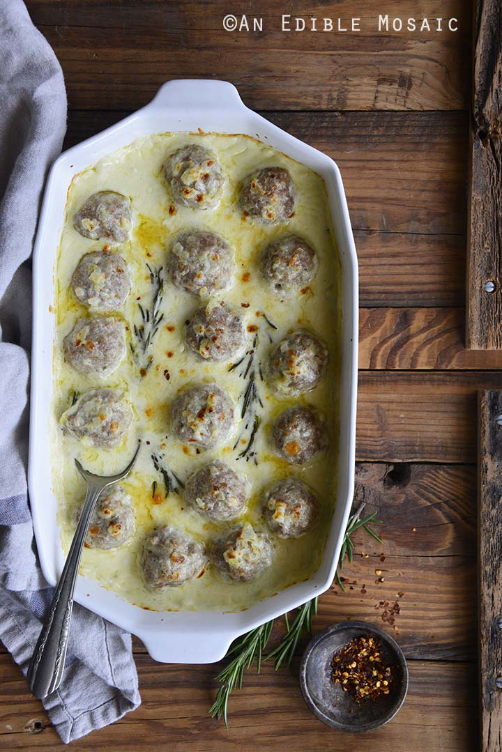 Low Carb Cheesy Turkey Meatballs with Rosemary Cream Sauce in Casserole Dish