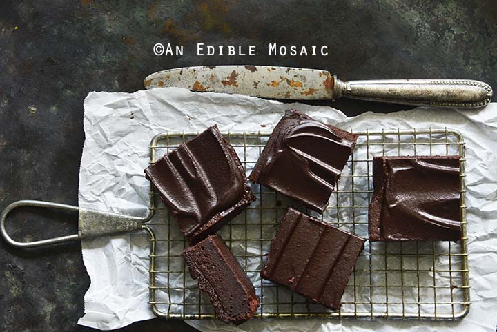 Fudgy Guinness Brownies with Dark Chocolate Ganache Recipe on Wire Rack with Parchment Paper