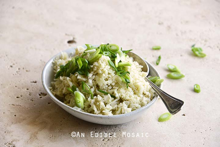 Front View of a Dish of Cauliflower Rice with Scallion Garnish