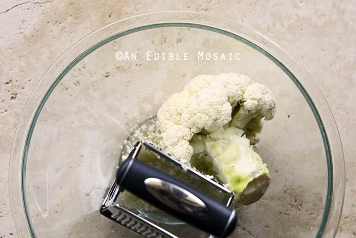 grating cauliflower head to make riced cauliflower