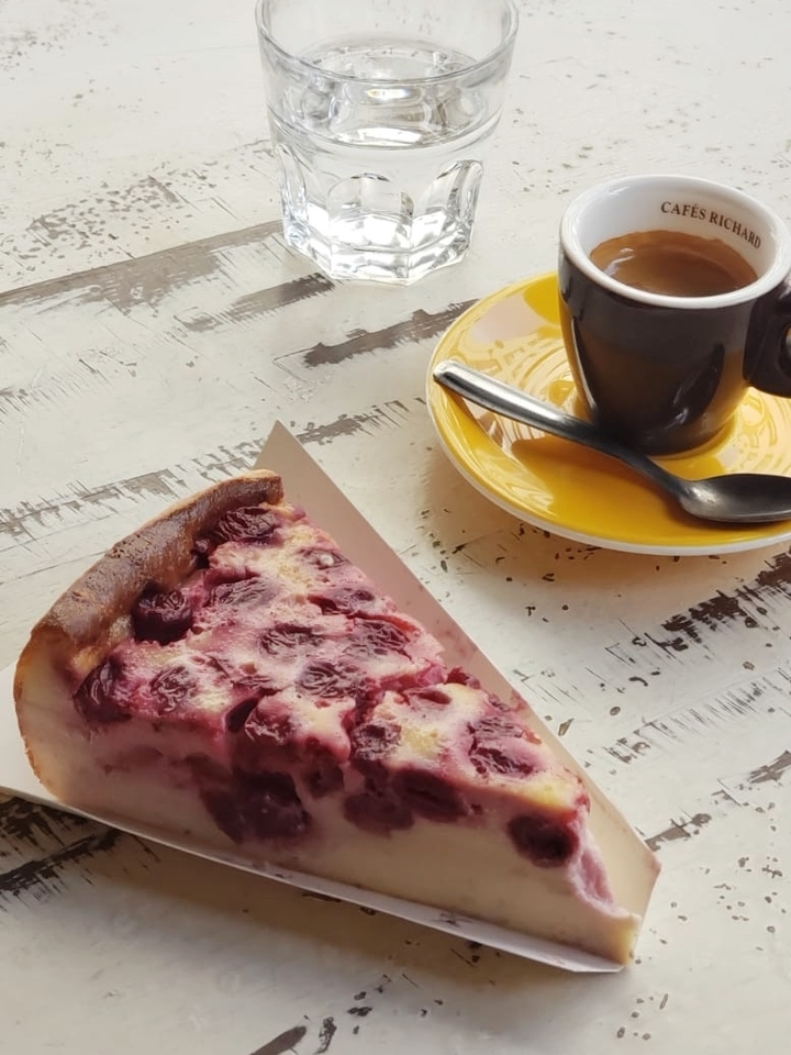 Clafoutis on Light Yellow Table with Espresso