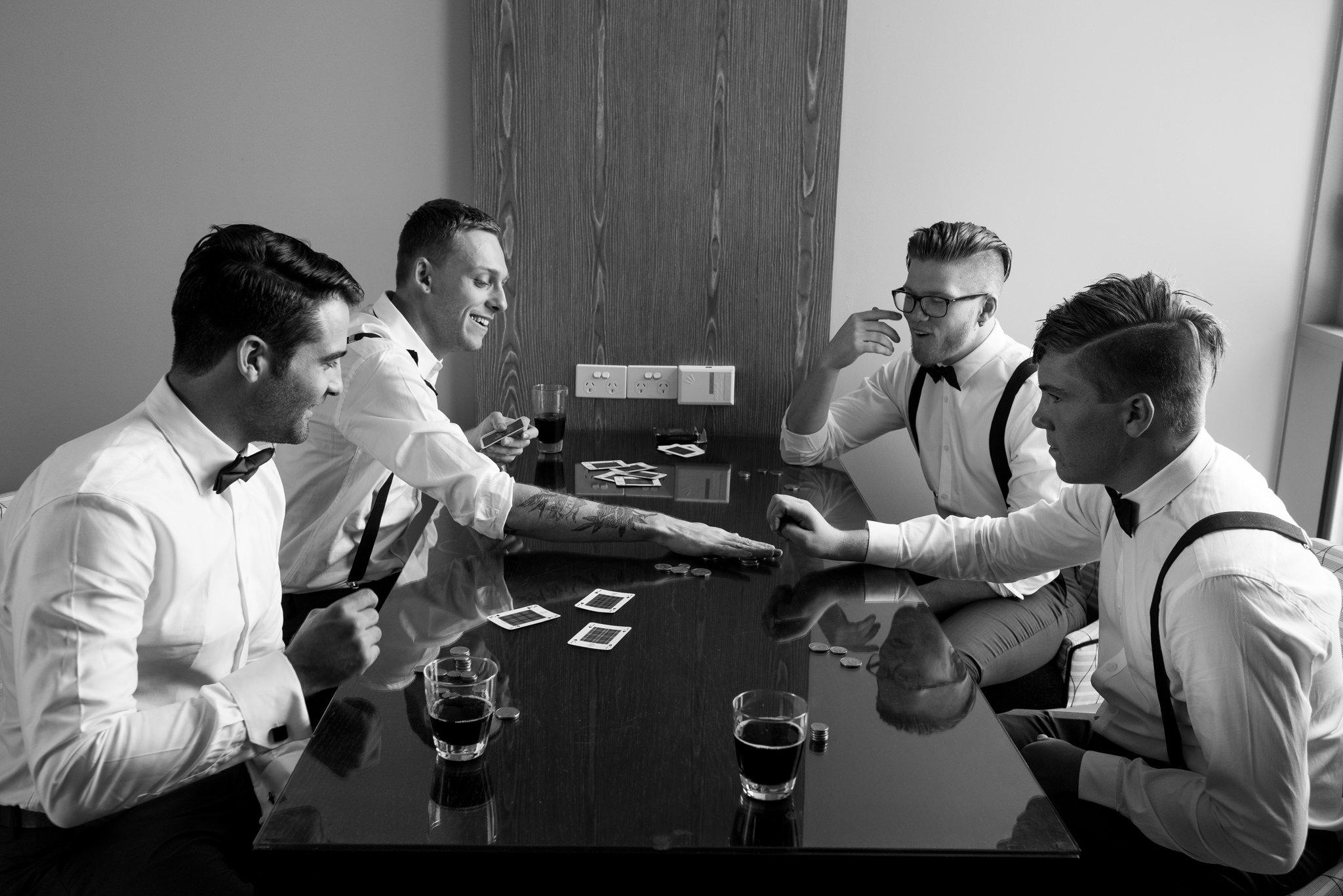 groomsmen playing poker