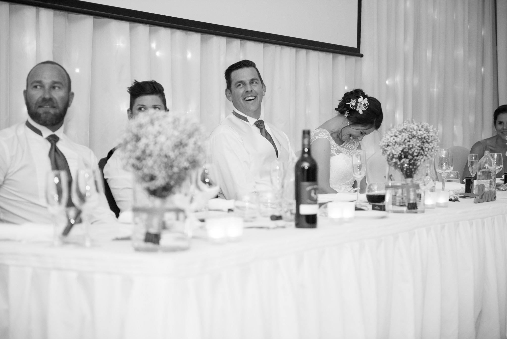 bride and groom reacting to speaches