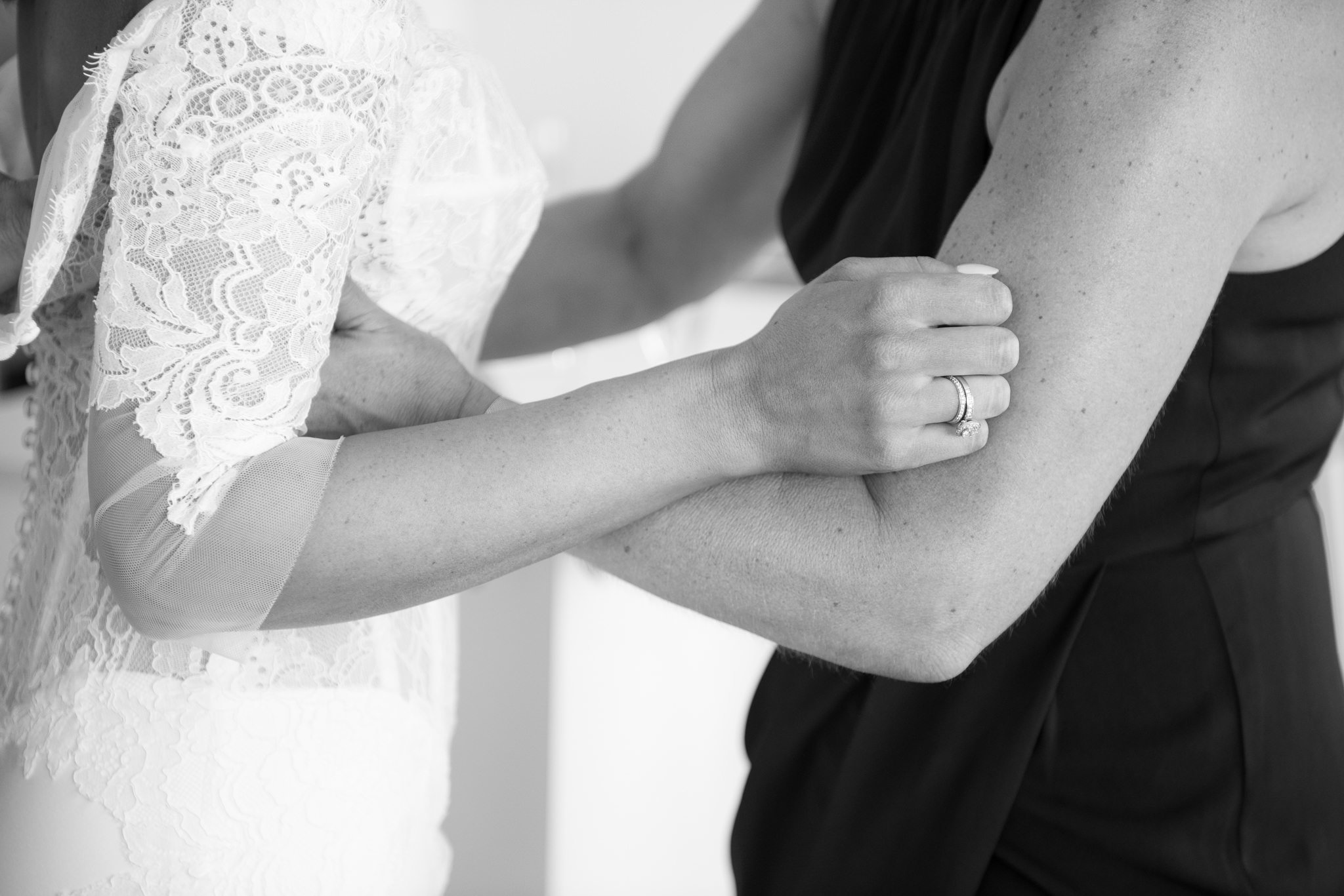 bride and mother arm tangle