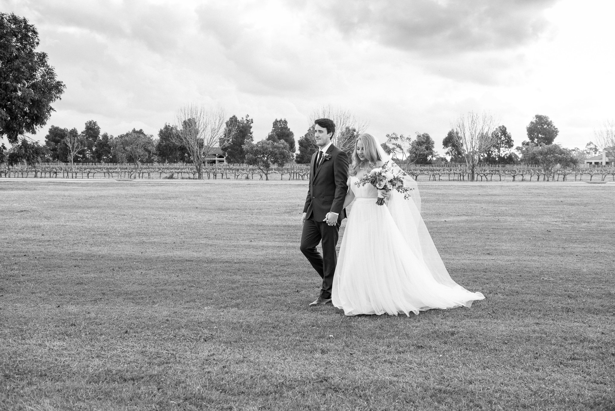 black and white Bride and groom walking